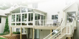whie house with sunroom on deck