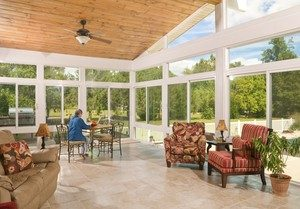 sunroom with furniture & wood ceiling