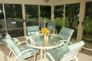 outdoor table in enclosed deck area