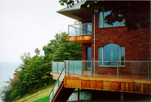 red brick house with glass railings