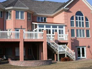 brick house with deck & sunroom