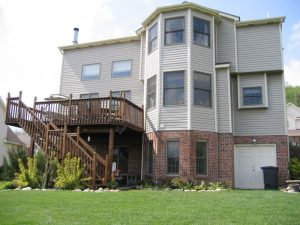 rear of a house with a raised deck