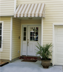 tan awning on yellow house