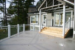 deck with wood steps & white railings