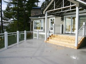 white railings on deck with wood steps